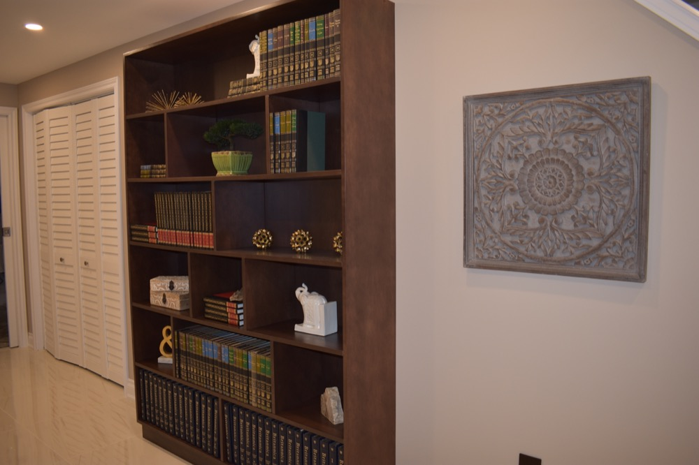classic book shelves, wooden mandala decoration on the wall design