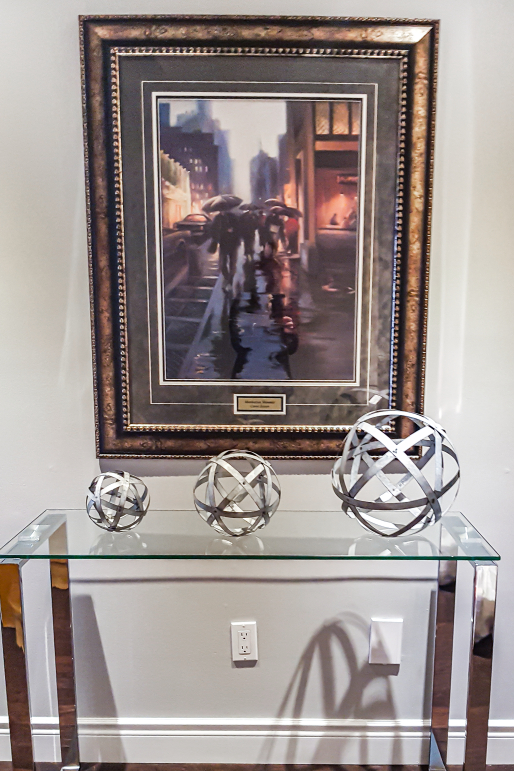 beautiful wall painting and metal ball table decoration