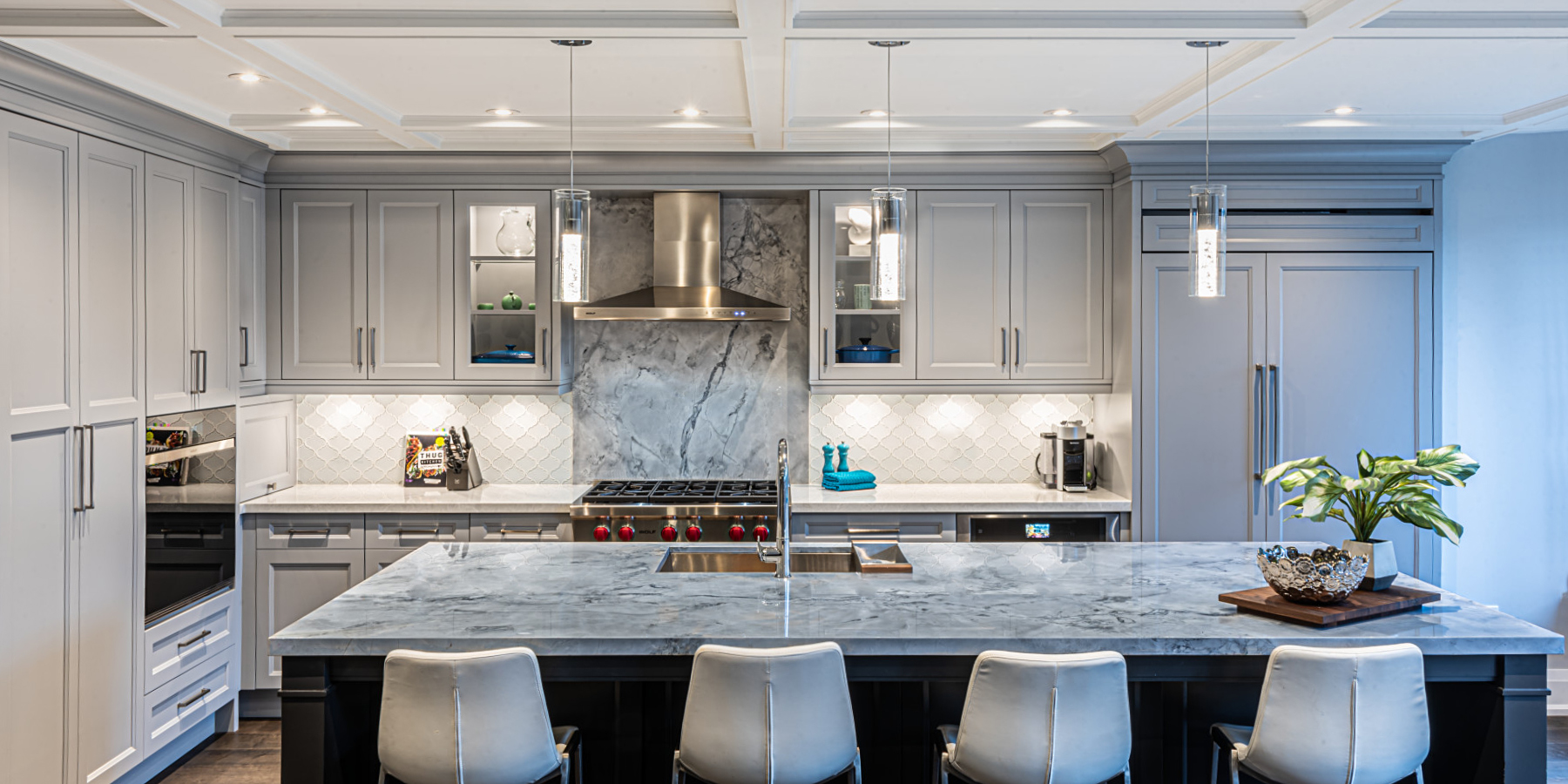 modern open concept kitchen with large natural stone island