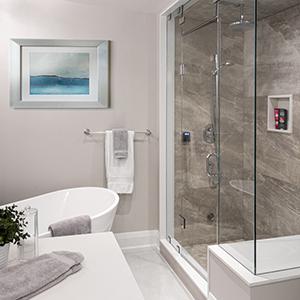 modern master bathroom with steam shower and free standing bathtub