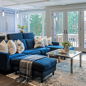 large blue sectional sofa with a chaise, ottoman & custom table