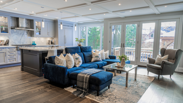 Transitional open concept kitchen - living room, large blue sectional sofa