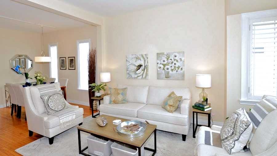 staging living room and dining area white sofa classic concept