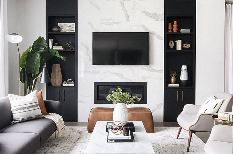 modern living room with custom millwork, white tile on chimney breast, & gas fireplace